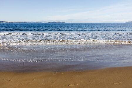 beautiful pristine Tasmanina beach with serene blue sky on a winter morning Stock Photo - 148961675