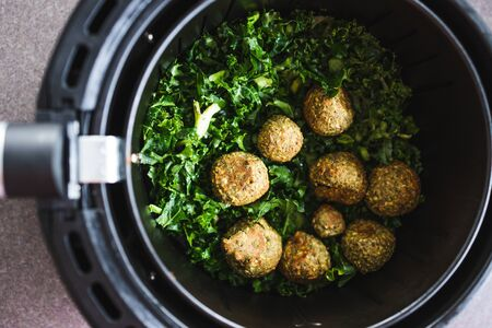 healthy plant-based food recipes concept, falafels and kale chips in air fryer Stock Photo - 148961780