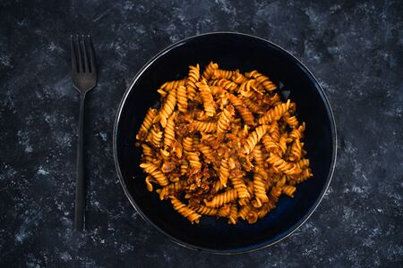 healthy plant-based food recipes concept, vegan fusilli pasta with lentil sauce