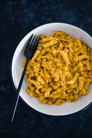 healthy plant-based food recipes concept, vegan fusilli pasta with dairy-free mustard sauce