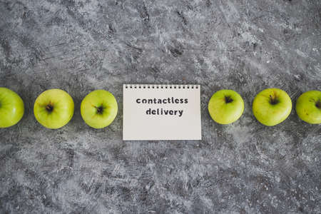 the new normal after covid-19, Contactless Delivery text on notepad among apples concept of groceries shopping during quarantine or lockdown