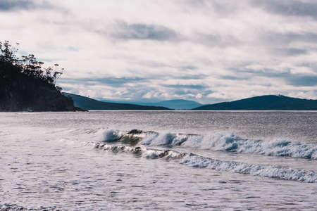 beautiful Tasmanian beach landscape with cloudy sky and cold contrasty tones Stock Photo