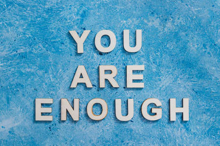 mental health and self-worth concept, You are enouugh text with blue background Banque d'images