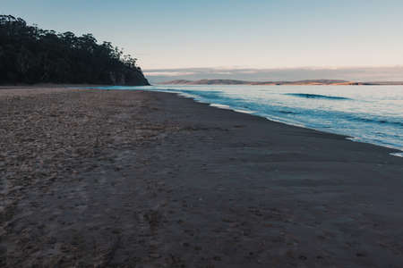 beautiful pristine Tasmanian beach in South Hobart at dusk without people