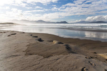 pristine untouched Australian beach in Marion Bay in Tasmania with no people and ocean looking powerful