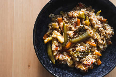 healthy plant-based food recipes concept, vegan fried rice with stir fry vegetables in sweet and sour sauce