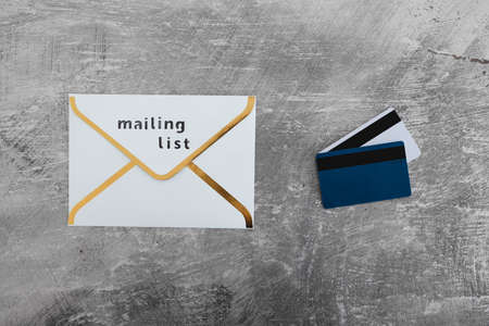 email marketing and promoting online sales concept, email icon with Mailing List label and payment cards