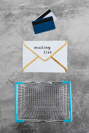 email marketing and promoting online sales concept, Mailing List email envelope icon with payment cards and shopping cart