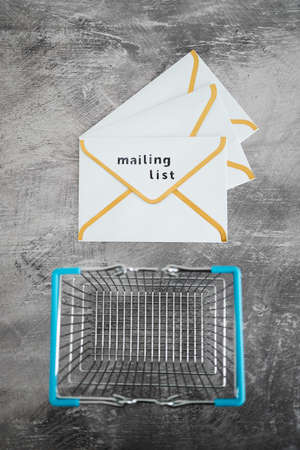 email marketing and promoting online sales concept, Mailing List email envelope icon with shopping cart
