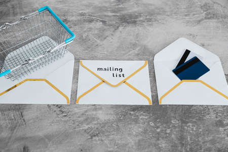 email marketing and promoting online sales concept, Mailing List email envelopes icon with shopping cart and payment cards