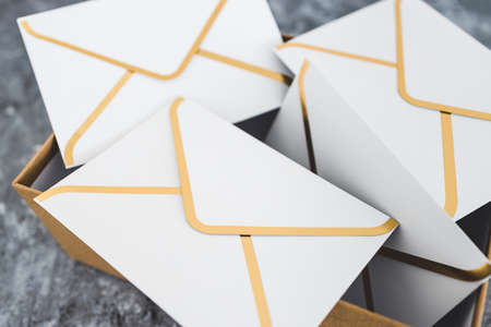 concept of inbox organisation and clean-up, group of envelopes inside box metaphor of email inbox
