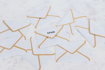 concept of inbox organisation and clean-up, spam email envelopes surrounded by other emails