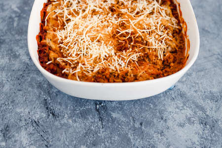 healthy plant-based food recipes concept, vegan lentil ragu lasagna with dairy-free white sauce and parmesan