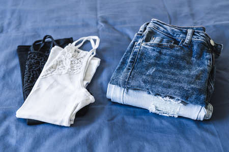 tidying up and organizing your wardrobe, Minimalism label on set of two jeans and two tops in different colors