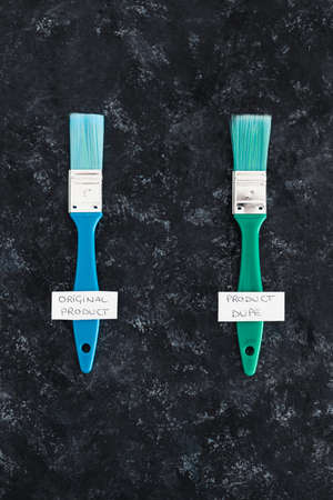 concept of imitations and unfair competition, half price vs full price tags with Original vs Dupe product labels underneath similar paint brushes