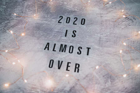 fetive fairy lights with text 2020 is almost over, concept of facing the challenges caused by the outbreak of the covid-19 virus on a global scale