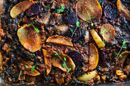 healthy plant-based food recipes concept, vegan veggie roast with potatoes beetroot and kale as main ingredients