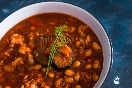 healthy plant-based food recipes concept, vegan aubergine beans and rise stew Stock Photo