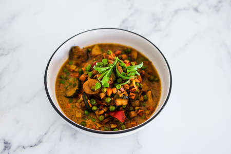 healthy plant-based food recipes concept, potatoes and garden vegetable roast with vegan broth and fresh tarragon