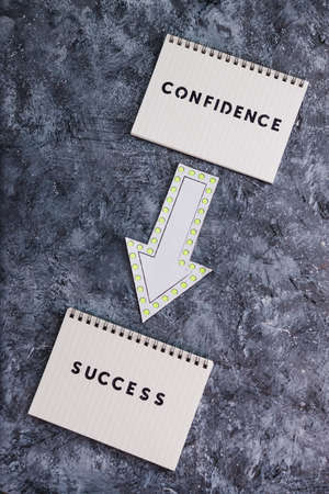 psychology and attitude concept, from Confidence to Succcess message with notepads and arrow