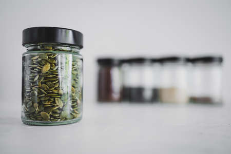 simple food ingredients concept, seed jars with sesame poppy pupmkin chia and flax seeds as important nutrient sources for nutrition shot on white background