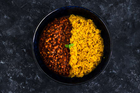 vegan spiced turmeric risotto with lentil mushroom ragout bolognaise sauce, healthy plant-based food recipes Stock Photo