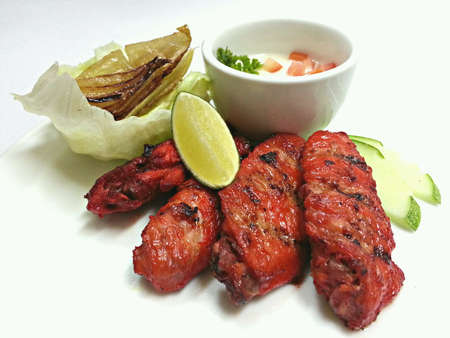 grill: Grilled Tandoori Flavoured Chicken Wings Stock Photo