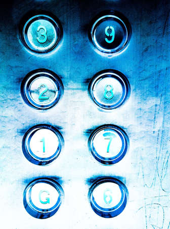 glow: Elevator buttons panel glowing in the dark Stock Photo
