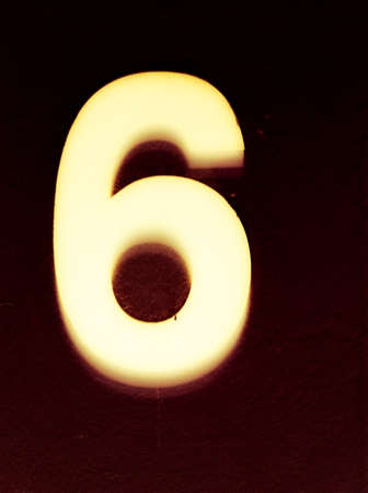 glow: Number 6 glowing in the dark Stock Photo