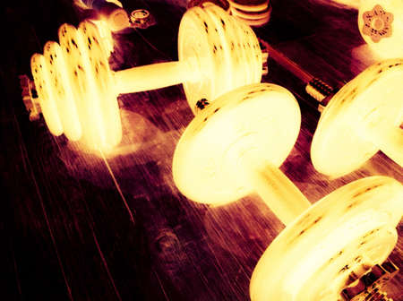 glow: Dumbbells glowing at night Stock Photo