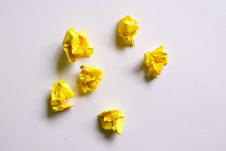 Top view of six yellow crumpled paper isolated on white background. Stock Photo