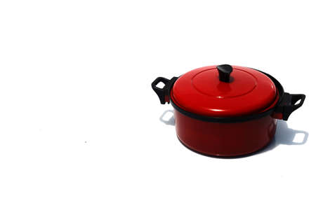Miniature cooking pot isolated on white background with copy space. Stock Photo