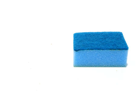 Blue scouring pad and sponge isolated on white background with copy space. Banco de Imagens