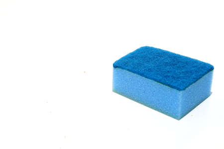 Blue scouring pad and sponge isolated on white background with copy space. Imagens