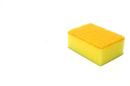 Yellow scouring pad and sponge isolated on white background with add text message.scouring pad and sponge is a cleaning tool used for scouring a surface and cleaning a dishes after cooking. Banco de Imagens - 91748390