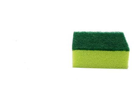 Green scouring pad and sponge isolated on white background with copy space.scouring pad and sponge is a cleaning tool used for scouring a surface and cleaning a dishes after cooking. Banco de Imagens - 91748319