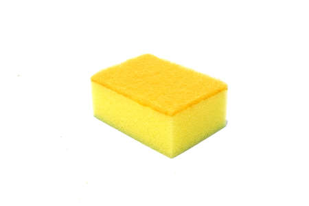 Yellow scouring pad and sponge isolated on white background. scouring pad and sponge is a cleaning tool used for scouring a surface and cleaning a dishes after cooking.