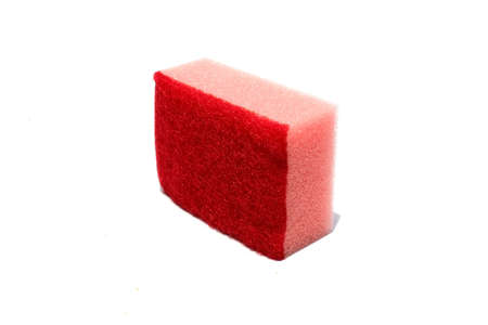 Red scouring pad and sponge isolated on white background.scouring pad and sponge is a cleaning tool used for scouring a surface and cleaning a dishes after cooking.