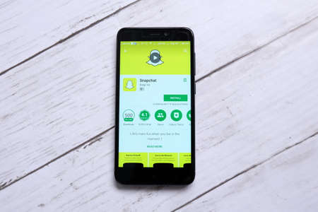 Kuala Lumpur,Malaysia - January 28th,2018 : Top view of smartphone with Snapchat on an android Play Store.Snapchat is an image messaging and multimedia mobile application created by Evan Spiegel, Bobby Murphy, and Reggie Brown.