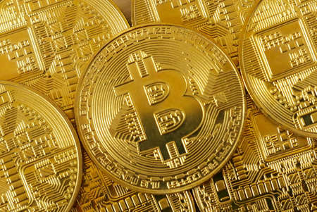 Golden bitcoin replica.