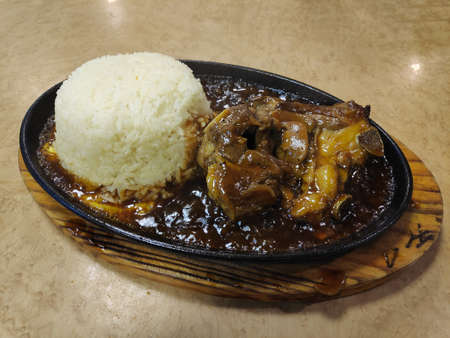 Hot sizzling black paper lamb with rice Reklamní fotografie
