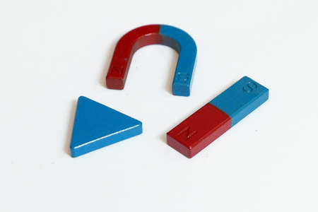 Blue and red color triangle,horseshoe and rectangular shape of magnet isolated on white background.