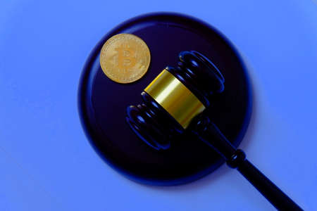 Law or auction concept with gavel and replica of gold bitcoin.Bitcoin cryptocurrency Internet business technology theme.
