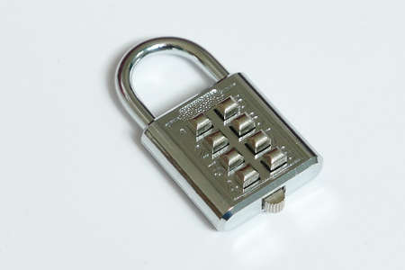 Metal combination pad lock isolated on white background.