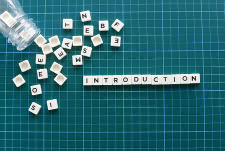 Introduction word made of square letter word on green background.