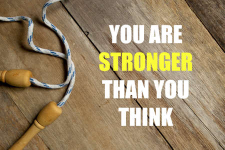 Inspirational motivational quotes You Are Stronger Than You Think on wooden background. Health and fitness concept. 免版税图像