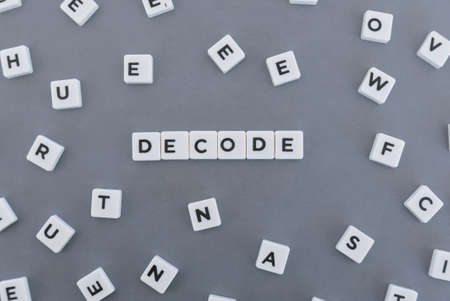 Decode word made of square letter word on grey background.