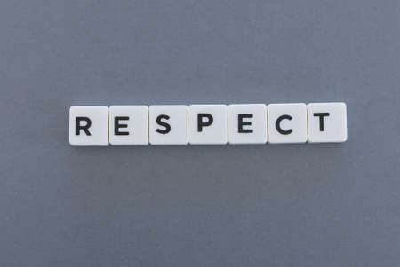 Respect word made of square letter word on grey background.