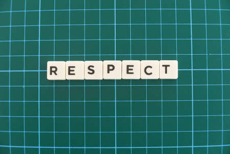 Respect word made of square letter word on green square mat background.