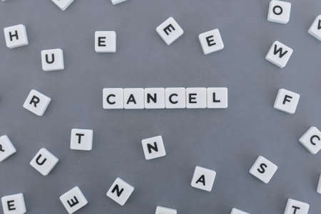 Cancel word made of square letter word on grey background.